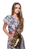 Beautiful blond girl playing on saxophone. Royalty Free Stock Image