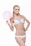 Beautiful blond girl posing with pink balloon and bubble gum. Royalty Free Stock Images