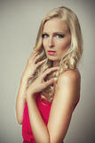 Beautiful blond girl in red Royalty Free Stock Photos