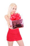 Beautiful blond girl in red dress holding gift box Royalty Free Stock Photo