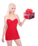 Beautiful blond girl in red dress holding gift box Stock Image