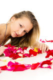 Beautiful blond girl with rose petals Royalty Free Stock Photos