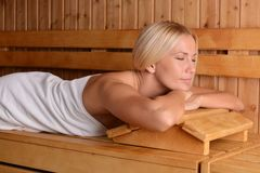 Beautiful blond girl in the Sauna Royalty Free Stock Photography