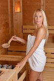 Beautiful blond girl in the Sauna Stock Images