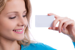 Beautiful blond girl showing business card Royalty Free Stock Photography