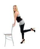 Beautiful   blond girl sitting on chair Stock Photography