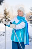 Beautiful blond girl with ski poles in hands during a short rest stock images