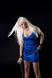 Beautiful blond girl stamd in blue cloth Stock Photo