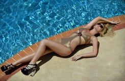 Beautiful blond girl taking sunbath Royalty Free Stock Photos
