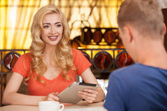 Beautiful blond girl talking with man. Stock Photos