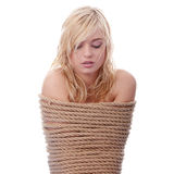 The beautiful blond girl tied with rope Stock Photography