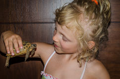 Beautiful blond girl with turtle Royalty Free Stock Photos