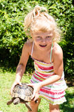 Beautiful blond girl with turtle Stock Photos