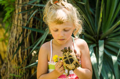 Beautiful blond girl with turtle Royalty Free Stock Photography