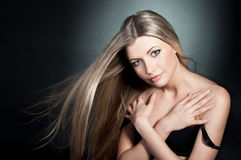 Beautiful blond girl wearing in black bra with blo Stock Photography