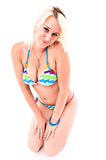 Beautiful blond girl wearing swimming costume Stock Photos