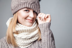 Beautiful blond girl wears winter scarf and hat Royalty Free Stock Image