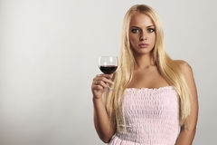 Beautiful blond girl with wineglass.blue dress.dry red wine.woman with alcohol. your text here Royalty Free Stock Image