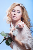 The beautiful blond girl with winter cosmetics Royalty Free Stock Image
