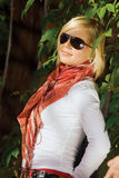 Beautiful blond girl in wood. Beautiful blond girl in black sun glasses in wood Stock Photo