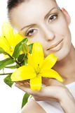Beautiful blond girl with yellow lily Stock Photos