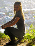 Beautiful blond girl. Beautiful young blond girl out in the nature with city view in the background Royalty Free Stock Photos