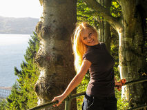 Beautiful blond girl. Beautiful young blond girl out in the nature with sunshine on her Royalty Free Stock Images