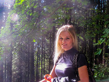Beautiful blond girl. Beautiful young blond girl out in the nature with sunshine on her Stock Photo