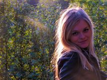 Beautiful blond girl. Beautiful young blond girl out in the nature with sunshine on her Stock Photography