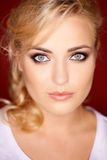 Beautiful blond with grey blue eyes Stock Photos