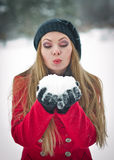 Beautiful blond hair girl in winter clothes Stock Photos