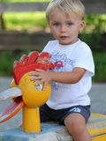 Beautiful blond hair little boy at the playground.  Stock Photography