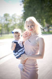 Beautiful blond hair mother and daughter Royalty Free Stock Images