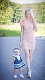 Beautiful blond hair mother and daughter Royalty Free Stock Image