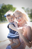 Beautiful blond hair mother and daughter Stock Images