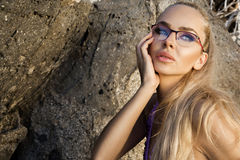 Beautiful blond hair sexy woman young girl model in sunglasses and elegant black swimsuit Stock Images