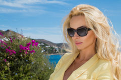 Beautiful blond hair woman young girl model in sunglasses in yellow dress, elegant jacket Royalty Free Stock Photo