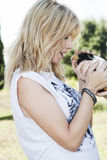 Beautiful blond hair woman holding cute pet bunny Stock Photos