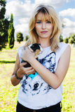 Beautiful blond hair woman holding cute pet bunny Royalty Free Stock Image