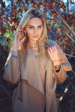 Beautiful blond hair woman posing outdoor Stock Photography