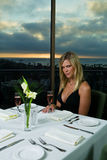 Beautiful Blond having dinner Stock Photography