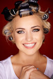 Beautiful blond with her hair in curlers Stock Image