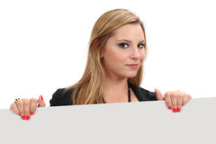 Beautiful blond holding blank sign Royalty Free Stock Photos