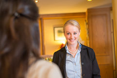 Beautiful blond hotel receptionist Stock Photography