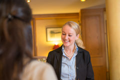 Beautiful blond hotel receptionist Royalty Free Stock Photos