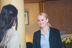 Beautiful blond hotel receptionist Stock Photos