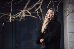 Beautiful blond lady against blue old door Stock Photo