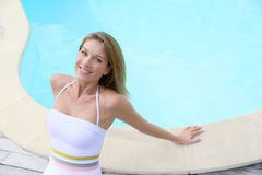 Beautiful blond lady by the pool Royalty Free Stock Photo
