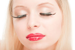 Beautiful blond with lengthen eyelashes. Portrait of attractive Blond woman with lengthen eyelashes and closed eyes, isolated on white Stock Images