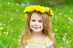 Beautiful blond little girl with a floral head wreath Stock Photography